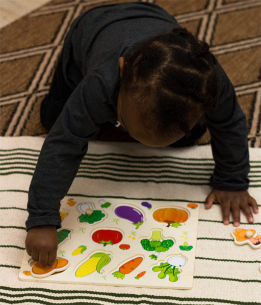 child coloring and playing